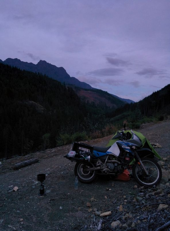 Should have edited this to brighten it, but it was a quick shot to send to Davi... bike, tent behind, and Mt Arrowsmith in background. Funny black thing in front is stove with dinner on it.